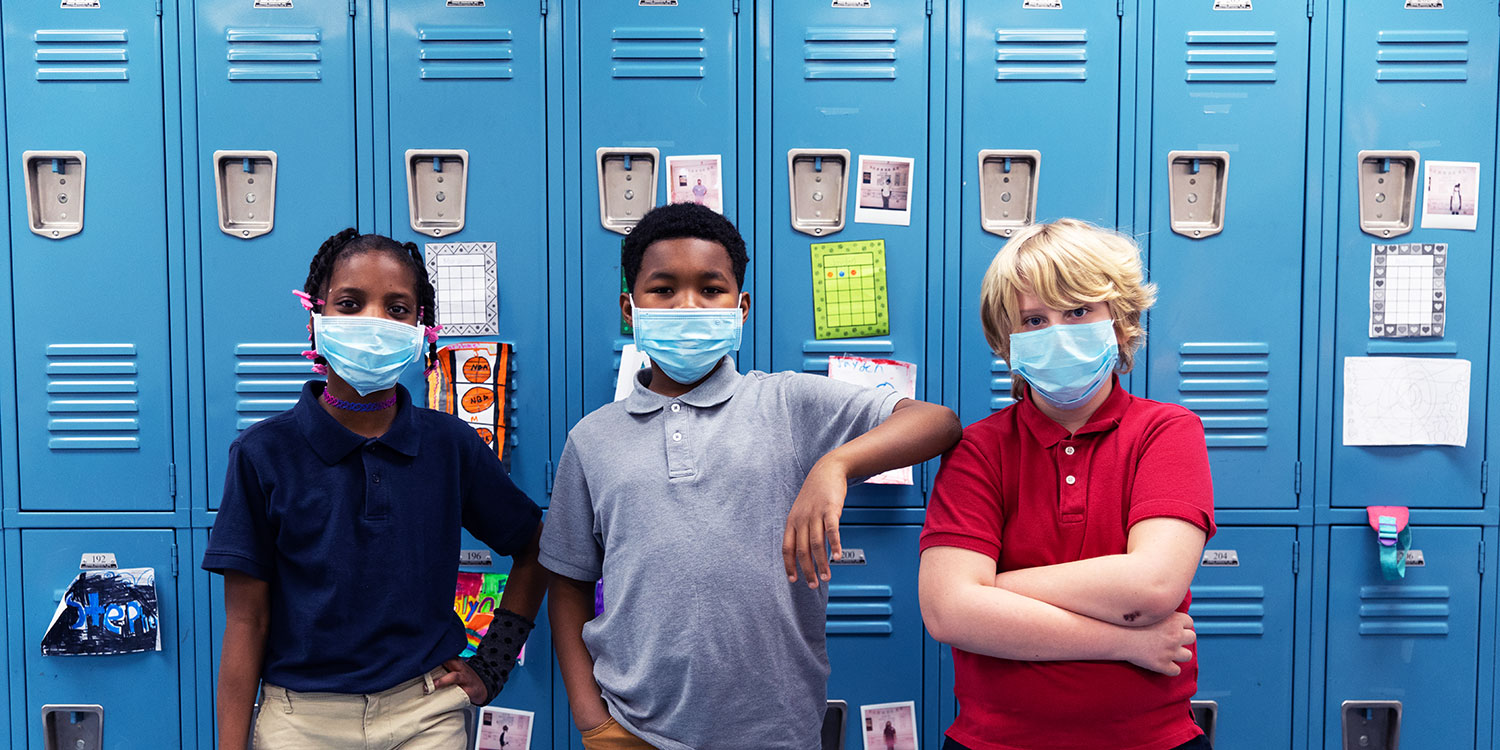 Masked students standing next to each other in front of lockers at Case Prep.